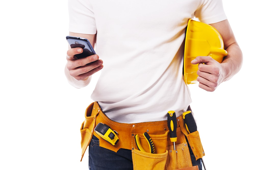 construction worker using a mobile phone