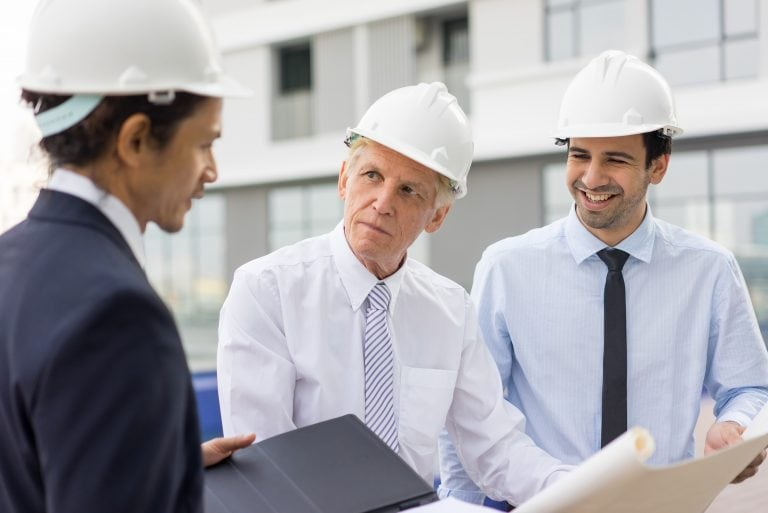 Construction Managers Discussing Blueprint